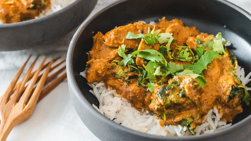 bowl of butter chicken with rice