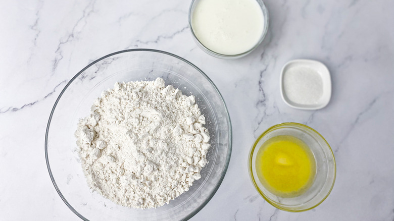 biscuit ingredients in bowls on counter