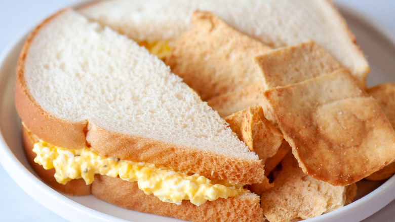 egg salad recipe and chips plated