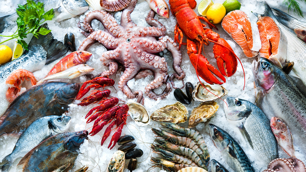 Variety of colorful seafood on ice