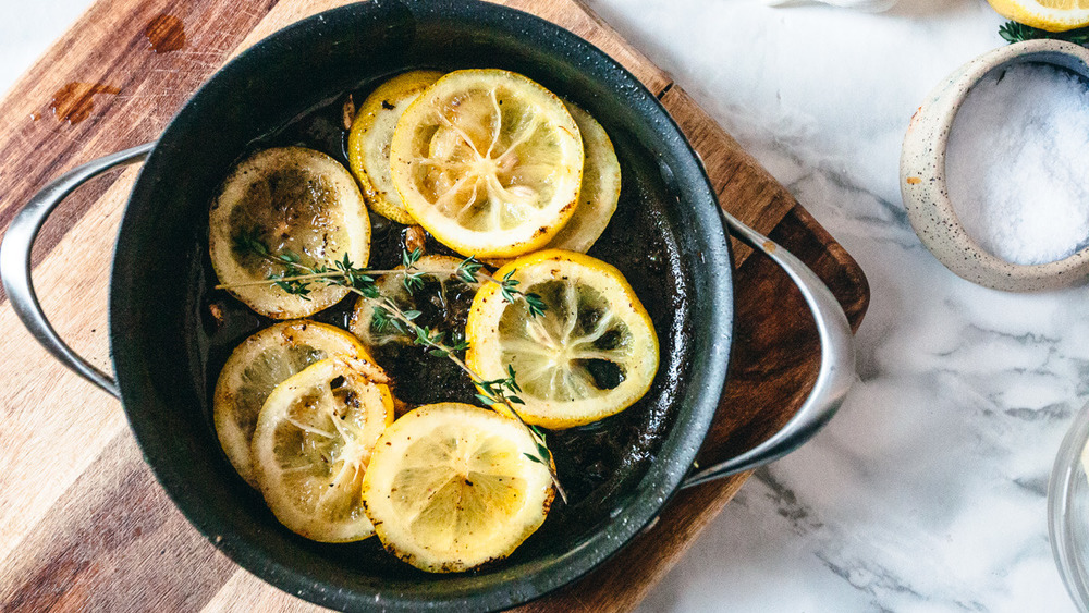 browned lemon slices in pan