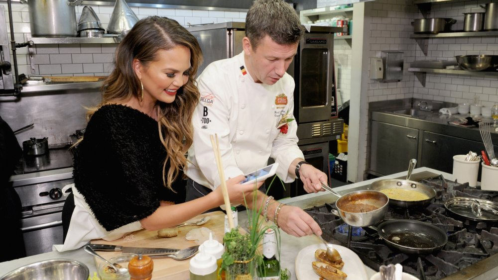 Chrissy Teigen throwing it down in the kitchen like a Chopped chef