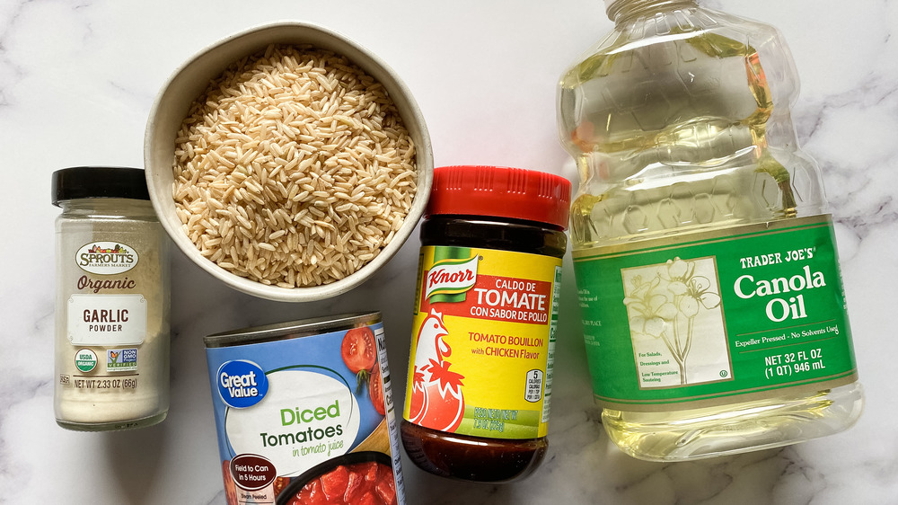 Mexican rice ingredients placed on counter