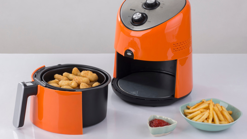 Air fryer mozzarella sticks and french fries