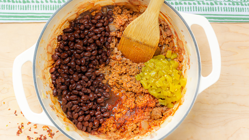 cooking black beans and chiles for one-pot stuffed bell peppers recipe