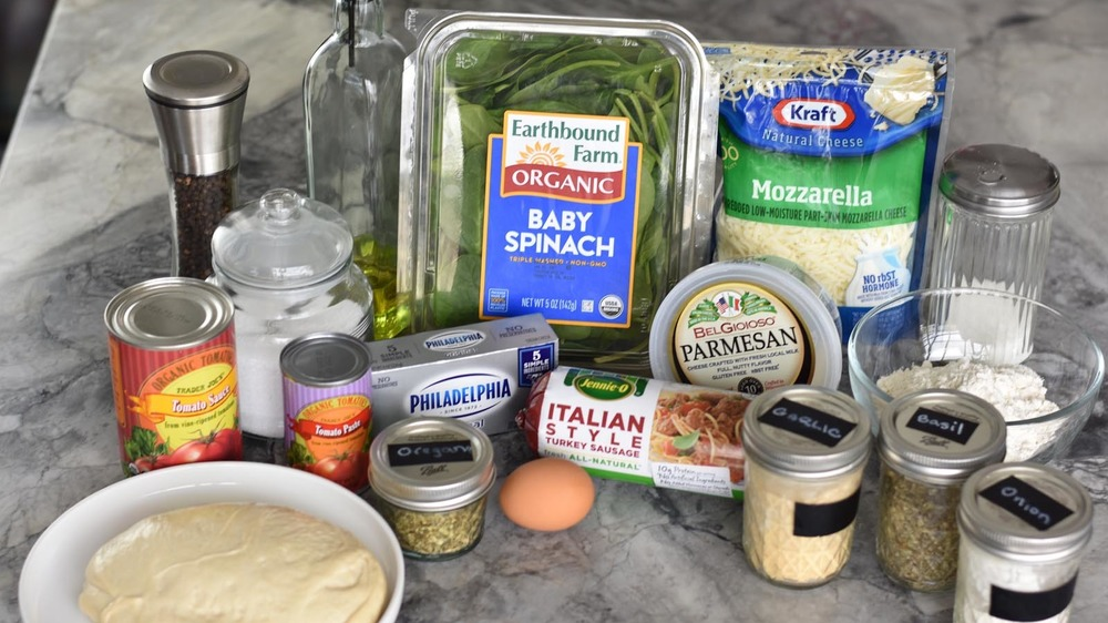 Ingredients to make calzones and dipping sauce